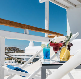 Mykonos Essence Hotel luxury services. Cocktails, loungers, pool and sea views.