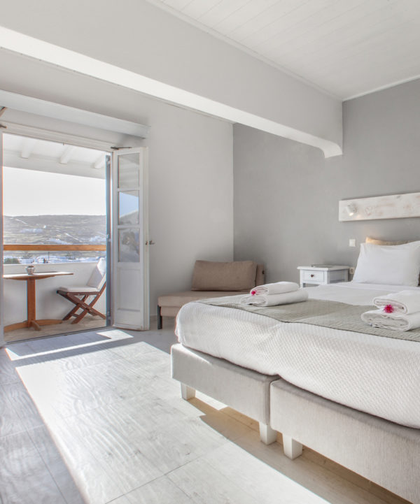 The Mykonos Essence Hotel Superior Rooms with partial sea views, offers spacious accommodation for up to 3 people.