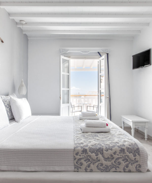 The Deluxe Rooms with sea view offer luxurious accommodation options in Mykonos that are ideal for couples.